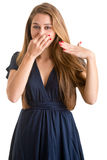 Female Covering Her nose Stock Photography