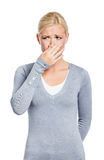 Female covers nose with hand Stock Photography