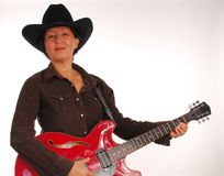 Female cowboy with guitar Royalty Free Stock Images