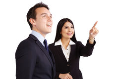 Female coworker pointing while male coworker is looking royalty free stock image
