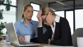 Female coworkers chatting, having coffee break in office, complaining about work stock video footage