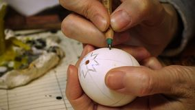 Female craftman hands creating easter egg stock video footage