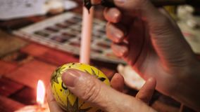 Female craftman hands creating easter egg stock footage