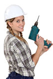 Female craftswoman holding drill Stock Photos