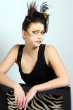 Female with Crazy Makeup and Hair Wearing a Little Black Dress Stock Image