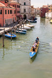 Female crew is training on a rowing boat in venice canal. Stock Images