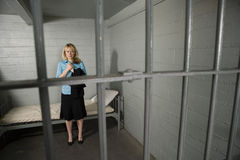 Female Criminal Behind Bars Stock Photos