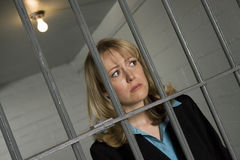 Female Criminal Behind Bars In Jail Stock Image