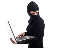 Female criminal with the laptop Stock Images