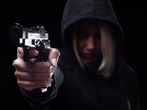 Female criminal shooting with gun on the street Royalty Free Stock Images