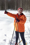 Female cross country skier gives the thumbs up sign Stock Image