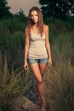 Female with crossed legs outdoors stock photo