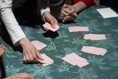 Female croupier shuffling cards on gambling table Stock Photography