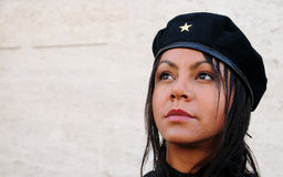 Female Cuba. Young lady wearing black jacket and hat looking out of frame with a reference to Ernesto Che Guevara in style Stock Photography