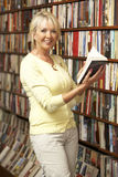 Female customer in bookshop Stock Photo
