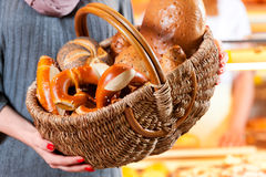 Female customer with bread basket in bakery Stock Photos
