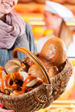 Female customer with breadbasket in bakery Royalty Free Stock Image