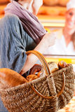 Female customer with breadbasket in bakery Royalty Free Stock Photo