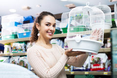 Female customer buying cage for quinea Royalty Free Stock Photography