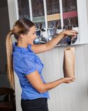 Female Customer Buying Coffee From Vending Machine Royalty Free Stock Images