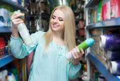Female customer buying detergents for laundry Royalty Free Stock Image