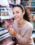 Female customer buying lip butter gloss Stock Images