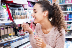 Female customer buying lip butter gloss Stock Photos