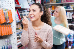 Female customer buying lip butter gloss Royalty Free Stock Photos