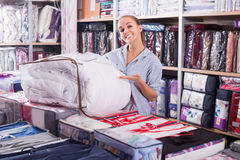 Female customer buying new blanket and coverlet Stock Photography