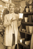Female customer choosing flower pot Stock Image