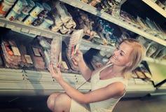 Female customer choosing fresh meat Royalty Free Stock Photos