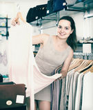 Female customer choosing pullover at store Royalty Free Stock Photo