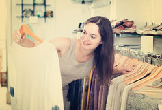 Female customer choosing pullover at store Stock Images