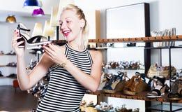 Female customer choosing shoe Royalty Free Stock Image