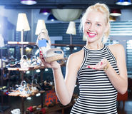 Female customer choosing shoe Royalty Free Stock Photo