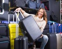 Female customer choosing travel suitcase Royalty Free Stock Photo