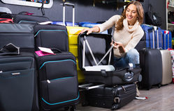 Female customer choosing travel suitcase Stock Photography