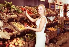 Female customer choosing vegetables and fruits Royalty Free Stock Photo