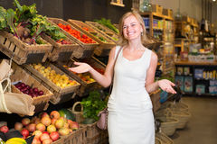 Female customer choosing vegetables and fruits Royalty Free Stock Images