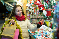 Female customer at the Christmas Fair Royalty Free Stock Images