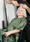 Female Customer Getting Haircut In Salon Royalty Free Stock Image