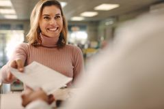 Female customer giving prescription to pharmacist royalty free stock image
