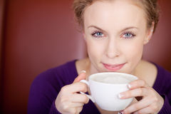 Female Customer Having Coffee In Cafe Stock Image