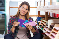 Female Customer Holding Envelops By Shelves Royalty Free Stock Photos