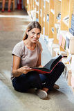 Female Customer Holding File While Sitting Cross Royalty Free Stock Photo