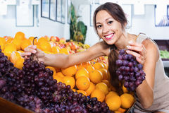 Female customer holding ripe bunch of grapes Stock Image