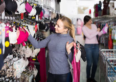 Female customer holding various lingerie in hands in underwear s Stock Photography