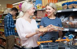 Female customer looking at assortment of fresh pastry Stock Photography