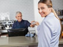 Female Customer Making Payment Through Credit Card Royalty Free Stock Images