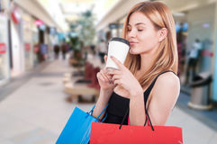 Female customer in the mall with shopping bags Royalty Free Stock Images